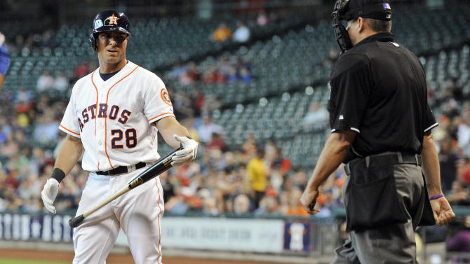 Houston Astros' Rick Ankiel, left, looks to home plate umpire Andy Fletcher after striking out against the Texas Rangers in the second inning of a baseball game Wednesday, April 3, 2013, in Houston. (AP Photo/Pat Sullivan)