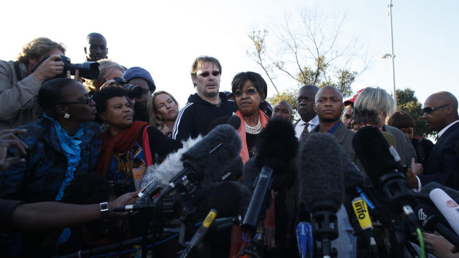 Winnie Madikizela-Mandela addresses the media in front the house of her former husband and former South African President Nelson Mandela in Soweto, Friday, June 28, 2013. Members of Nelson Mandela's family as well as South African Cabinet ministers have visited the hospital where the 94-year-old former president is critically ill. (AP Photo/Markus Schreiber)