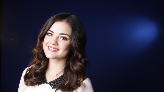 """FILE - This Nov. 20, 2012 file photo shows actress Lucy Hale posing for a portrait in New York. Hale stars in the ABC Family series, """"Pretty Little Liars."""" (Photo by Carlo Allegri/Invision/AP, file)"""