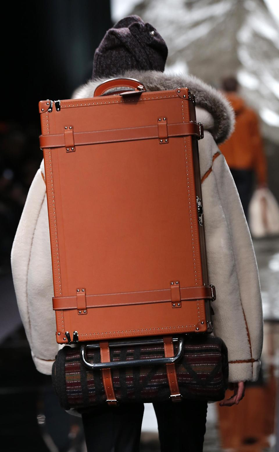 A model presents a back case by British fashion designer Kim Jones for Louis Vuitton's fall-winter 2013/2014 men's fashion collection, presented in Paris, Thursday, Jan.17, 2013. (AP Photo/Jacques Brinon)
