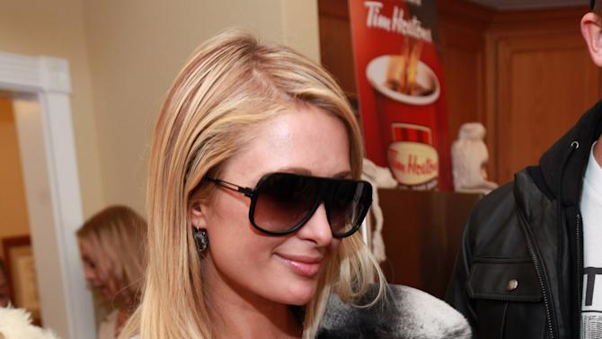 IMAGE DISTRIBUTED FOR FENDER - Paris Hilton is seen at the Fender Music lodge during the Sundance Film Festival on Sunday, Jan. 20, 2013, in Park City, Utah. (Photo by Barry Brecheisen/Invision for Fender/AP Images)
