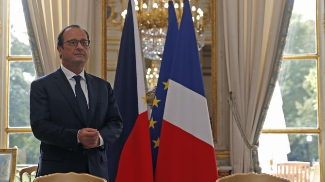 French President Hollande is seen before a signature ceremony attended by Philippine President Aquino at the Elysee Palace in Paris
