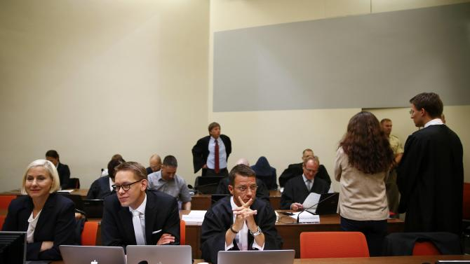 Lawyer Grasel speaks to defendant Zschaepe next to lawyers Sturm, Heer and Stahl as they wait for the continuation of her trial at a courtroom in Munich
