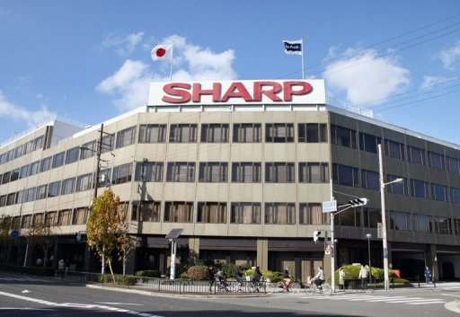 <p>File photo of Sharp's headquarters in Osaka, western Japan. Sharp will book a record $5.6 billion annual net loss, reports said Thursday, a day after rival Panasonic warned of a mammoth $9.6 billion loss for its fiscal year.</p>