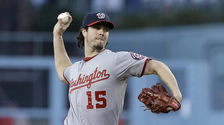Washington Nationals  starter Dan Haren pitches to the Los Angeles Dodgers in the first inning of a baseball game in Los Angeles Tuesday, May 14, 2013. (AP Photo/Reed Saxon)