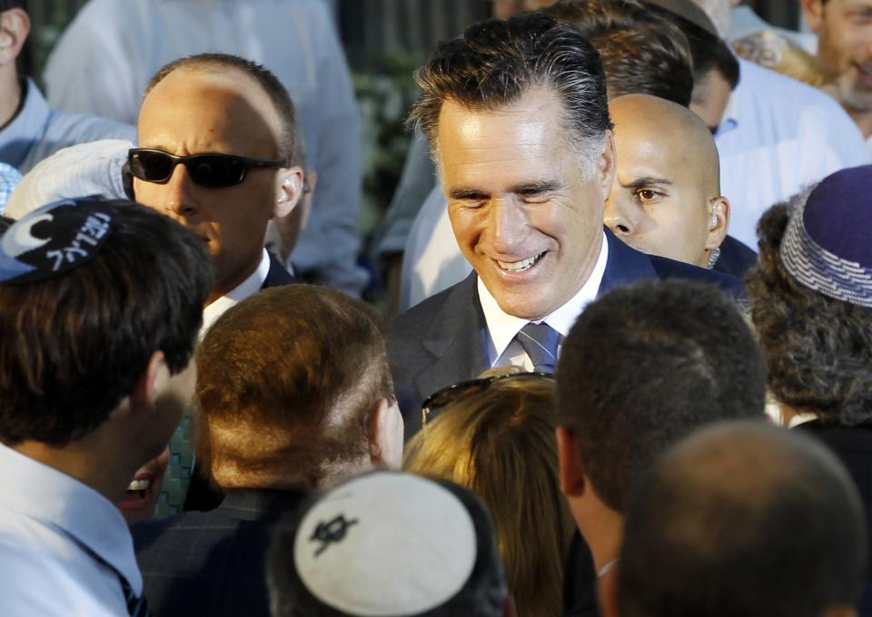 Republican presidential candidate and former Massachusetts Gov. Mitt Romney talks to American businessman Sheldon Adelson, who has said he will donate millions to Romney's campaign, after he delivered a speech in Jerusalem, Sunday, July 29, 2012. (AP Photo/Charles Dharapak)