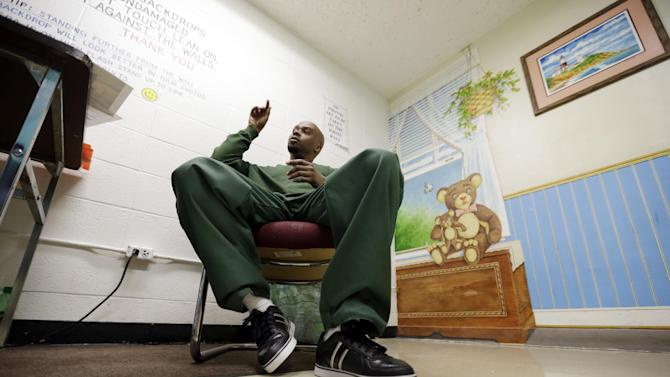 HOLD FOR STORY BY CAROLYN THOMPSON - Attica Correctional Facility inmate Valentino Dixon talks about his golf art he creates in prison in Attica, N.Y., Thursday, May 16, 2013.   While serving a 39-year-to-life sentence for a murder he says he did not commit, Dixon draws, spending 10 to 12 hours a day illustrating a kind of serenity he has never known. (AP Photo/David Duprey)