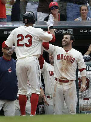 Cleveland Indians' Jason Kipnis, right, congratulates Michael Brantley after Brantley hit a two-run home run off Detroit Tigers relief pitcher Al Alburquerque in the eighth inning of a baseball game, Sunday, July 7, 2013, in Cleveland. Nick Swisher scored. The Indians won 9-6. (AP Photo/Tony Dejak)