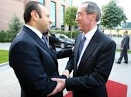 "Egemen Bagis (left) greets French Interior Minister Claude Gueant before a a meeting in Ankara last October. Bagis says Ankara would like to see France ""become one of the champions of Turkish integration in the EU,"" as it was under president Jacques Chirac"