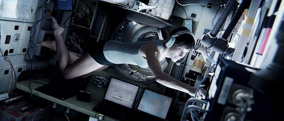 "This publicity photo released by Warner Bros. Pictures shows Sandra Bullock, left, as Dr. Ryan Stone in ""Gravity."" (AP Photo/Courtesy Warner Bros. Pictures)"