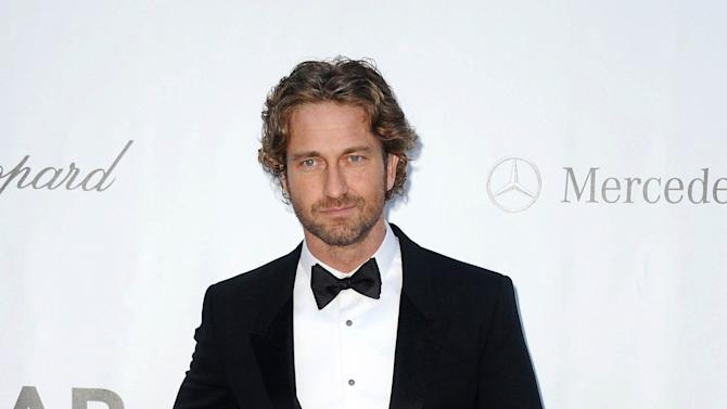 FILE - This May 24, 2012 file photo shows actor Gerard Butler at the amfAR Cinema Against AIDS benefit during the 65th Cannes film festival, in Cap d'Antibes, southern France. Gerard and actress Sarah Jessica Parker will host the 19th annual Nobel Peace Prize Concert on Dec. 11 in Oslo, Norway. Jennifer Hudson and Seal are among the performers. (AP Photo/Jonathan Short, file)