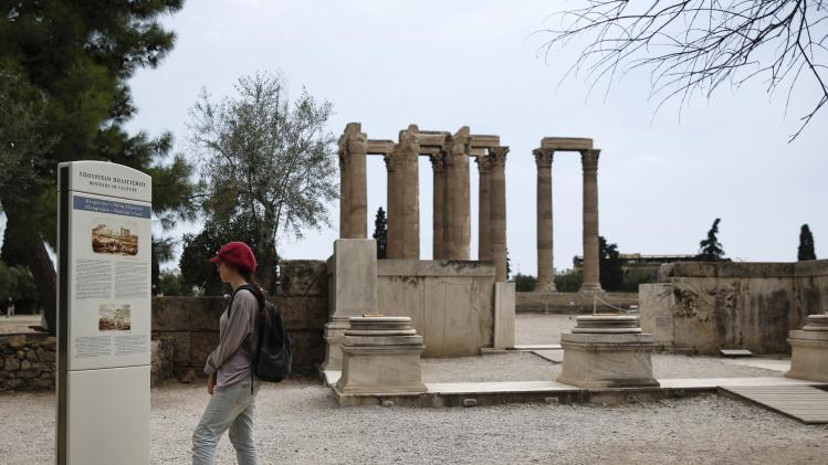 A tourist visits the sanctuary of Olympian Zeus in Athens