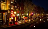 People walk through the red-light district, known as De Wallen, in Amsterdam, in 2011. A 527-year-old home that is believed to be the oldest in Amsterdam has been discovered in the red-light district, officials said Saturday