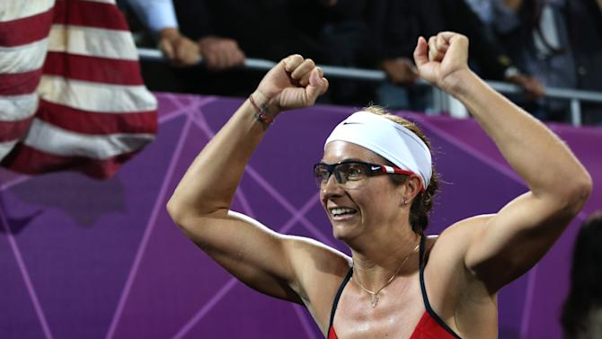 United States' Misty May-Treanor celebrates after winning the women's gold medal beach volleyball match at the 2012 Summer Olympics, Wednesday, Aug. 8, 2012, in London. (AP Photo/Petr David Josek)