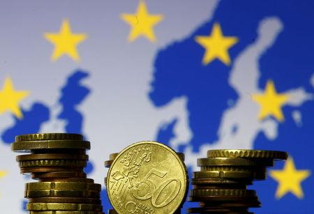 Euro coins are seen in front of displayed flag and map of European Union in this picture illustration taken in Zenica
