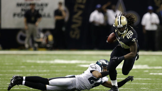 New Orleans Saints running back Chris Ivory (29) rushes past Philadelphia Eagles cornerback Nnamdi Asomugha (24) during the first half an NFL football game at the Mercedes-Benz Superdome in New Orleans, Monday, Nov. 5, 2012. The Saints won 28-13. (AP Photo/Bill Haber)