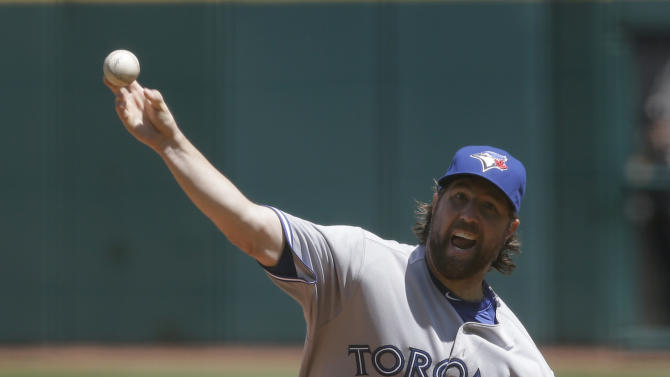 Toronto Blue Jays starting pitcher R.A. Dickey delivers a pitch in the first inning of a baseball game against the Cleveland Indians, Thursday, July 11, 2013, in Cleveland. (AP Photo/Tony Dejak)