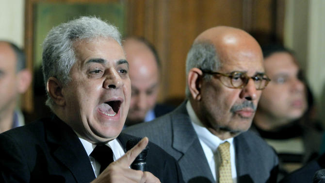 Former Egyptian presidential candidate, Hamdeen Sabahi, left, speaks during a press conference following the meeting of the National Salvation Front as former director of the U.N.'s nuclear agency and Nobel peace laureate, Mohamed El Baradei, right, listens in Cairo, Egypt, Monday, Jan. 28, 2013. Egypt's main opposition coalition has rejected the Islamist president's call for dialogue to resolve the country's political crisis, unless their conditions are met. (AP Photo/Amr Nabil)
