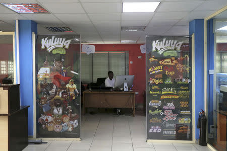 An employee works at the Kuluya Games office in Lagos