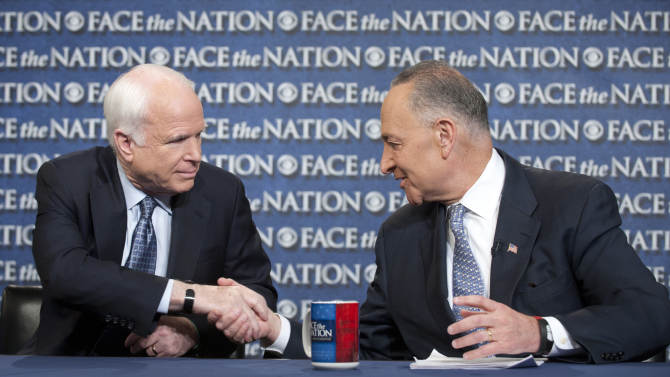 """In this photo released by CBS News Sen. John McCain, R-Ariz., and Sen. Chuck Schumer, D-N.Y., appear on Sunday, April 7, 2013, on's CBS's  """"Face the Nation"""".  McCain and Schumer spoke about gun legislation, the latest developments with North Korea and immigration.  (AP Photo/CBS News, Chris Usher)"""