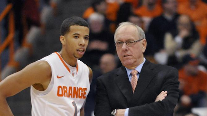 Syracuse coach Jim Boeheim talks with Michael Carter-Williams during the first half against Detroit in an NCAA college basketball game in Syracuse, N.Y., Monday, Dec. 17, 2012. (AP Photo/Kevin Rivoli)