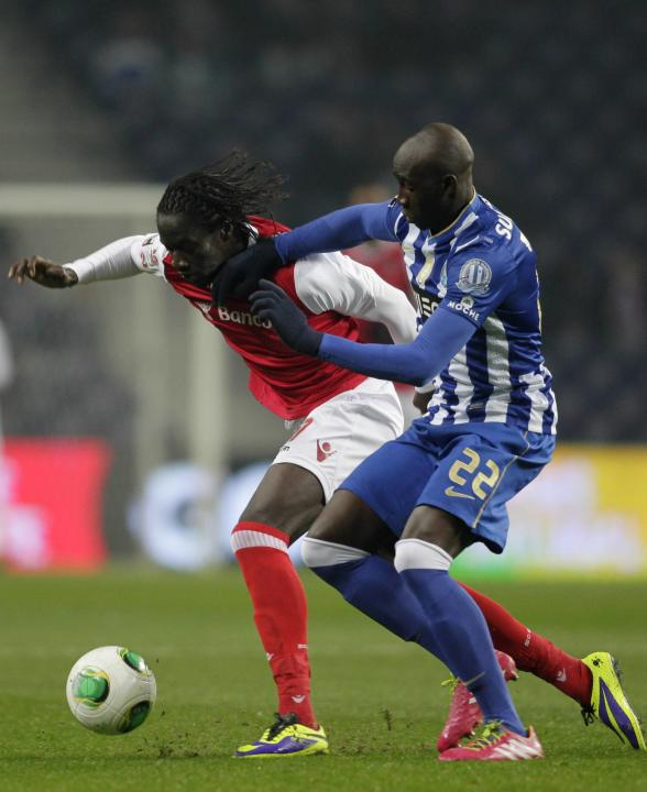 Porto's Mangala fights for the ball with Braga's Ederzito during their Portuguese Premier League soccer match at the Dragao stadium in Porto