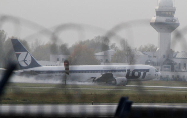 A Boeing 767 of Polish LOT airlines makes an emergency landing at Warsaw airport, Poland,Tuesday, Nov. 1, 2011. The plane was en route from Newark with 230 people onboard but no one was injured. (AP P