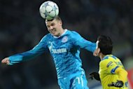 Igor Denisov (L) of Zenit St Petersburg fights for the ball against Constantinos Charalambides of APOEL FC during a UEFA Champions League match in Saint-Petersburg, 2011. Zenit Saint Petersburg midfielder Igor Denisov has branded new signing Hulk a second-rate star after being demoted from the first team for speaking out about the Brazilian striker&#39;s lucrative contract