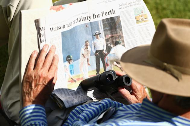 ADELAIDE, AUSTRALIA - NOVEMBER 26:  A spectator in the crowd reads the newspaper during day five of the Second Test Match between Australia and South Africa at Adelaide Oval on November 26, 2012 in Ad