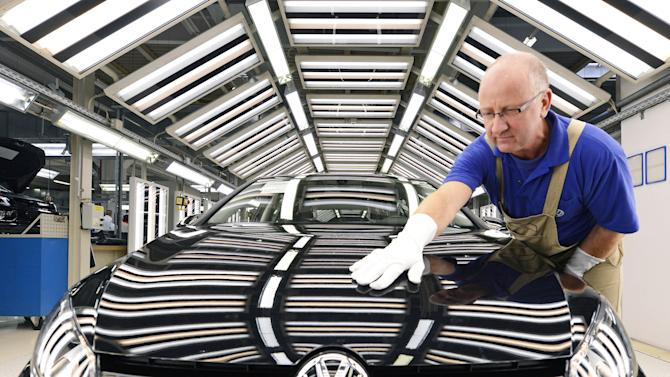 FILE - In this Nov. 9, 2012 file photo worker Michael Keil checks a Golf VII car during a press tour at the plant of the German car manufacturer Volkswagen AG (VW) in Zwickau, central Germany. Volkswagen AG says Thursday, Oct. 30, 2013, that net profit jumped 56 percent in the third quarter as the company sees continuing sales growth in China and Europe. Net profit rose to 2.97 billion euros (US dollar 3.8 billion) from 1.91 billion euros in the same quarter a year ago. Sales revenue rose 4.1 percent to 48.9 billion euros (US dollar 62.4 billion). (AP Photo/Jens Meyer,File)