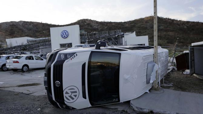 Damaged Volkswagen vehicle is seen outside a business selling cars in San Jose del Cabo, after Hurricane Odile hit Baja California