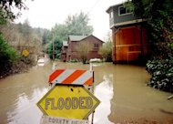Flooded homes along the Russian River in California. NOAA scientists and colleagues are installing the first of four permanent &quot;atmospheric river observatories&quot; in California this month, to better monitor and predict the impacts of powerful win