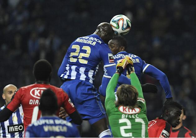 FC Porto's Eliaquim Mangala, centre left, from France scores the opening goal past Olhanense's goalkeeper Vid Belec, from Slovenia, in a Portuguese League soccer match at the Dragao Stadium in