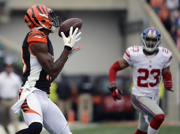 Cincinnati Bengals wide receiver A.J. Green, left, catches a 56-yard touchdown pass against New York Giants cornerback Corey Webster (23) in the first half of an NFL football game on Sunday, Nov. 11,