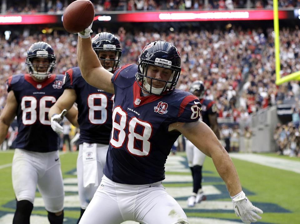 Houston Texans' Garrett Graham (88) spikes the ball after scoring a touchdown against the Buffalo Bills in the fourth quarter of an NFL football game on Sunday, Nov. 4, 2012, in Houston. (AP Photo/Eric Gay)