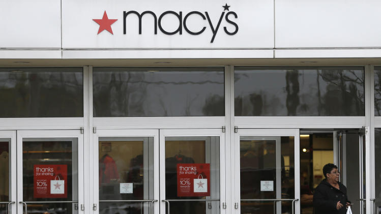 In this Monday, Nov. 11, 2013, photo, a woman walks out of Macy's department store in University Heights, Ohio. Macy's reports quarterly earnings on Wednesday, Nov. 13, 2013. (AP Photo/Tony Dejak)