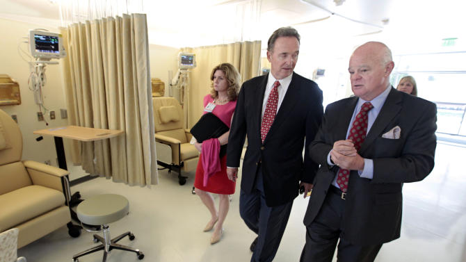 FILE -  In this Sept. 5, 2012, file photo, Rep. Dan Lungren, R-Calif., center, tours the soon-to-open University of California, Davis Comprehensive Cancer Center expansion with UC Davis Medical Center CEO Ann Madden Rice and cancer center director Ralph de Vere White, in Sacramento, Calif.  Lungren is running for reelection for California's 3rd Congressional District against Democrat Ami Bera. Lungren knows what it's like to have a big bull's eye plastered on his back. The Democratic Party and labor and environmental groups have spent $4.7 million on TV commercials and other efforts to unseat the nine-term Republican congressman from California. (AP Photo/Rich Pedroncelli, file)