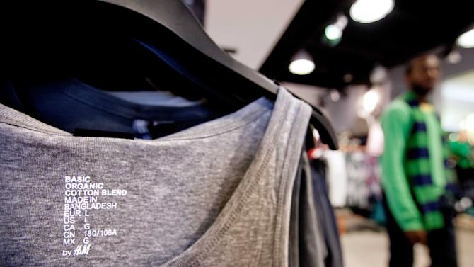 In this Wednesday, Dec. 12, 2012, photo, a tank-top made in Bangladesh is displayed in an H&M store in Atlanta. Global clothing brands involved in Bangladesh's troubled garment industry responded in starkly different ways to the building collapse that killed more than 600 people. Some quickly acknowledged their links to the tragedy and promised compensation. Others denied they authorized work at factories in the building even when their labels were found in the rubble. (AP Photo/David Goldman)