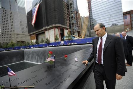 Howard Lutnick, head of Cantor Fitzgerald, visits the North Pool of the Memorial during ceremonies marking the 10th anniversary of the 9/11 attacks on the World Trade Center, in New York