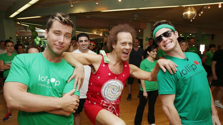 Lance Bass, Richard Simmons and Billy Bush at St. Patty's Day Slimdown benefiting the Lollipop Theatre Network held at Slimmons on Sunday, Mar., 17, 2013 in Beverly Hills, CA. (Photo by Eric Charbonneau/Invision for Lollipop Theatre Network/AP Images)