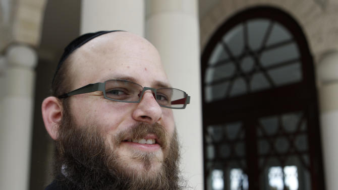 Rabbi Menachem Stern of Brooklyn, N.Y., stands outside of the Shul Jewish Community Center, Thursday, Dec. 8, 2011 in Surfside, Fla. Stern will be sworn in as an Army chaplain Friday after winning a legal fight against the military who had barred him from the position because he refused to shave his beard. Stern is a member of the Chabad Lubavitch movement of Judaism, whose rabbis are prohibited from shaving their beards. (AP Photo/ Lynne Sladky)