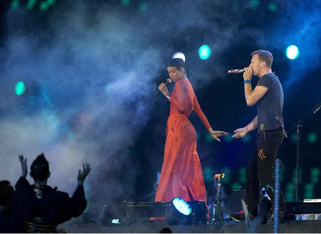 Singer Rihanna performs with Chris Martin lead vocals of the British rock band Coldplay during the closing ceremony for the 2012 Paralympics games, Sunday, Sept. 9, 2012, in London. (AP Photo/Matt Dun
