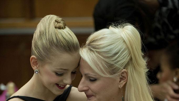 "Chloe and her mom Christy relax backstage after the competition in the second season of ""Dance Moms."""
