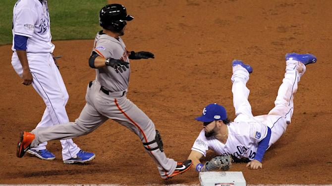 Eric Hosmer of the Kansas City Royals dives to tag out Gregor Blanco of the San Francisco Giants in the third inning during Game Two of the World Series, at Kauffman Stadium in Kansas City, Missouri, on October 22, 2014