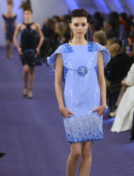 A model wears a creation by German Fashion designer Karl Lagerfeld as part of his presentation for Chanel Women's Spring Summer 2012 Haute Couture fashion collection presented in Paris, Tuesday, Jan. 24, 2012. (AP Photo/ Jacques Brinon)