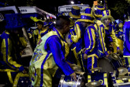 "Drummers of the murga ""Los amantes de La Boca"" prepare their instruments for carnival celebrations in Buenos Aires, Argentina, Saturday, Feb. 2, 2013. Argentina's carnival celebrations may not be as well-known as the ones in neighboring Uruguay and Brazil, but residents of the nation's capital are equally passionate about their ""murgas,"" or traditional musical troupes. The murga ""Los amantes de La Boca,"" or ""The Lovers of The Boca"" is among the largest, with about 400 members. It's a reference to the hometown Boca Juniors, among the most popular soccer teams in Argentina and the world. (AP Photo/Natacha Pisarenko)"