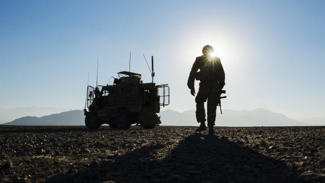 A U.S. soldier in Dragon Company of the 3rd Cavalry Regiment walks back to his MRAP vehicle in the Laghman province of Afghanistan