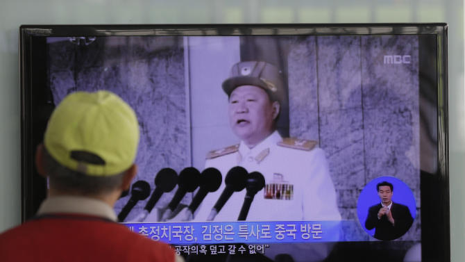"""A South Korean man watches a TV news reporting about North Korean leader Kim Jong Un's special envoy Choe Ryong Hae, at a Seoul Train Station in Seoul, South Korea, Wednesday, May 22, 2013. The """"special envoy"""" for North Korean leader Kim Jong Un left Pyongyang on Wednesday for China, the North's only major political and economic benefactor. State media released few details, but the trip comes at a rocky time in ties between the allies. (AP Photo/Lee Jin-man)"""