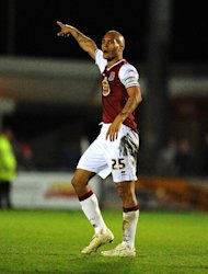 Clarke Carlisle was on loan at Northampton last season