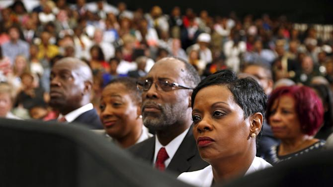 Attendees listen as Obama delivers remarks on the economy at Lawson State Community College in Birmingham, Alabama